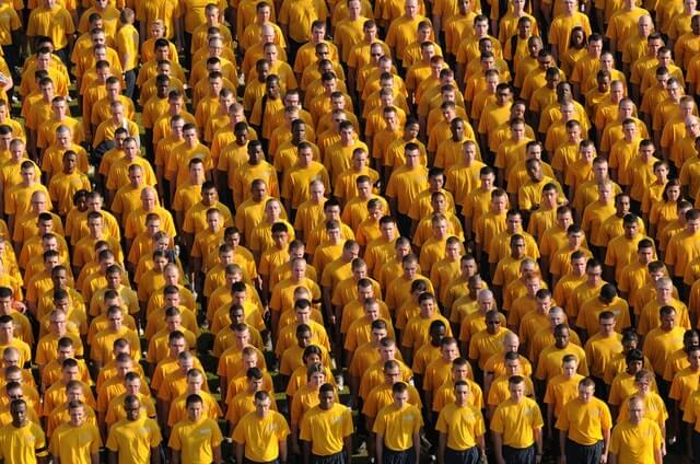 a large crowd of different people all wearing yellow t-shirts