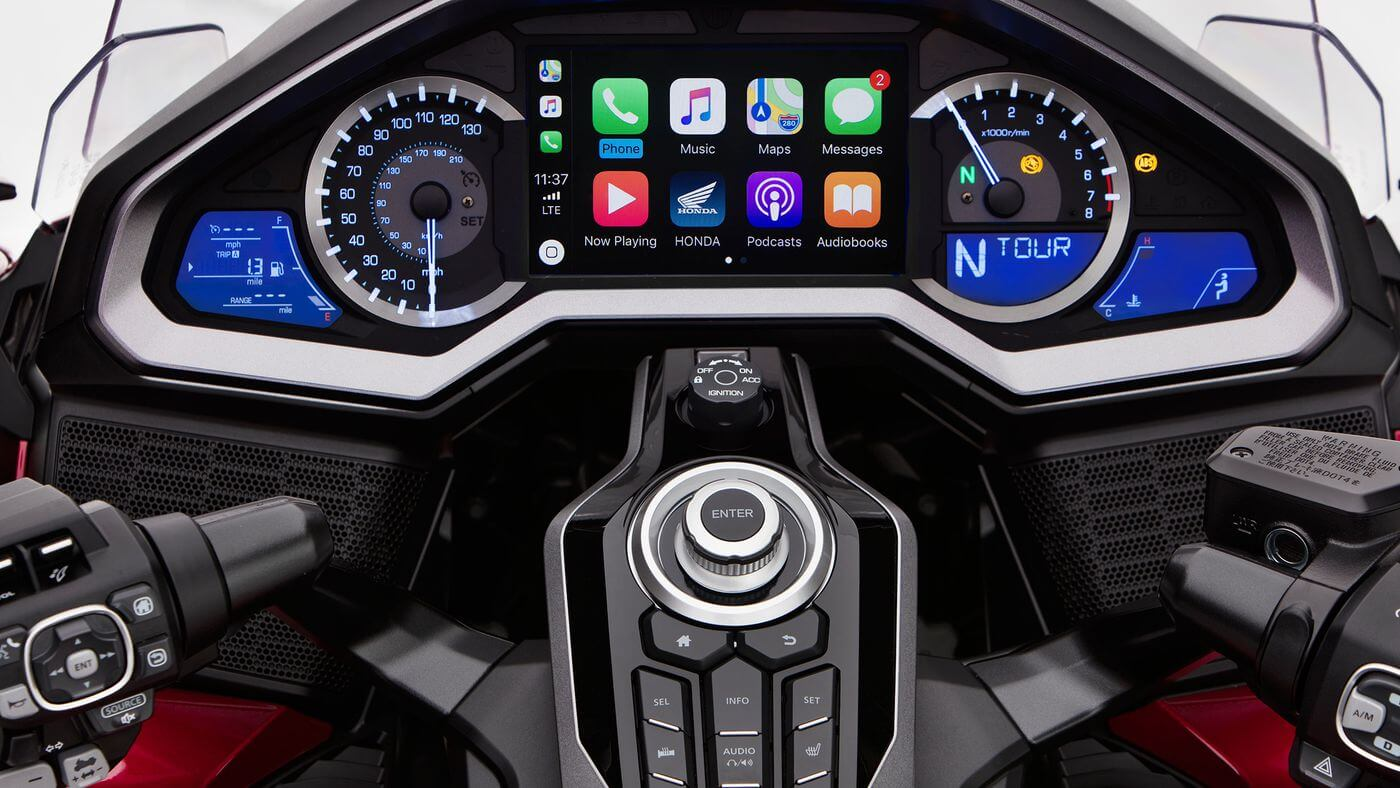 Honda Goldwing dashboard showing basic performance dials and digital displays with a central screen displaying Apple CarPlay